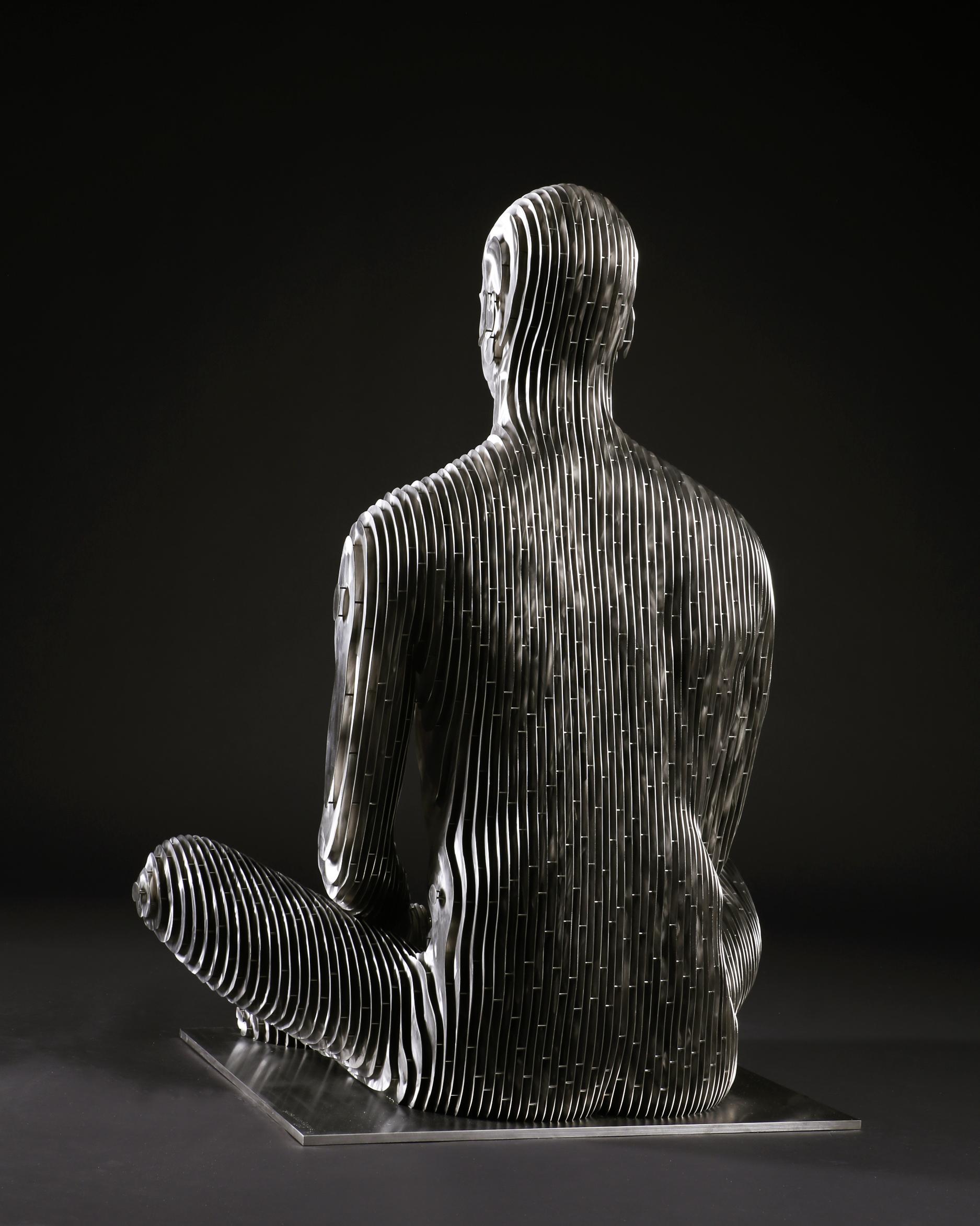 275_Life-size sitting Man